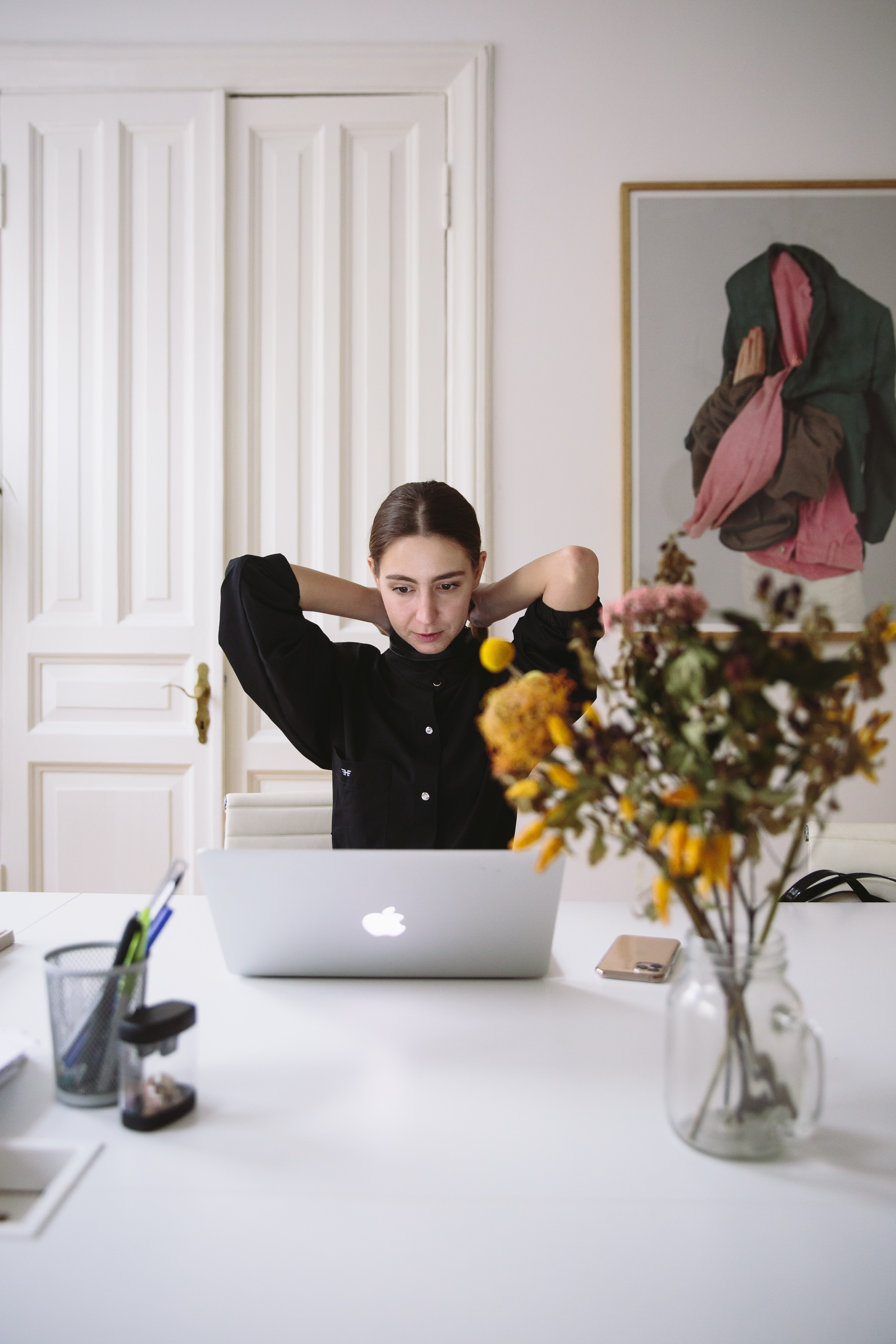 woman-in-black-blouse-sitting-in-front-of-silver-laptop-3747432
